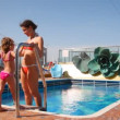 Mother with daughter near swimming pool — Stock Video