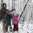 Mother with children in snow forest — Stock Video