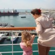 Woman and girl looks at ships in sea port — Stock Video