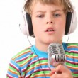 Boy in earphones talking through microphone — Stock Video