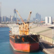 Stock Video: Freighter in port of Abu Dhabi, United Arab Emirates