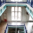 Stock Video: Multilevel interior of factory with escalators and ladders