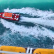Cutter sailing out cruise liner in sea — Stockvideo
