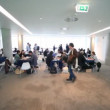 Sit at  discussion tables in  meeting hall on CEPIC Congress 2010 in Dublin — Stock Video