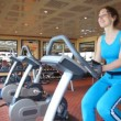 Woman training on exercise bicycle — Stock Video