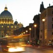 And vehicles passing on Via della Conciliazione at night — Stock Video