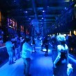 Stock Video: Front view on dance floor with men and women in some nightclub