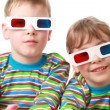 Boy and girl sit in anaglyph glasses for viewing stereo images and applaud — Stock Video