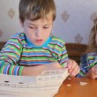 Boy and girl together constructing toy model of ship — Stock Video #27547345