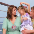 Family on cruise liner deck embracing — Stockvideo