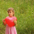 Girl is throwing up  an inflatable heart merrily — Stock Video