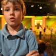 Stock Video: Boy standing in big TV studio with spectators