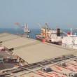 Stock Video: Trucks and ship in seaport in Abu Dhabi, UAE