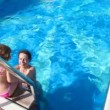 Stock Video: Womand girl having fun in swimming pool