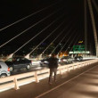 Cars stoped, walks on night Samuel Beckett Bridge — Stok video