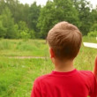 Stock Video: Boy is playing with a model of an aircraft