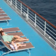 Stock Video: Woman and girl lying on deck chairs
