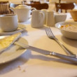 Flatware and corn flakes with milk on table in cafe — Vídeo Stock