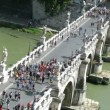 Many passing across Sant\'Angelo Bridge in Rome — Stock Video