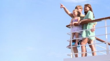 Family is standing at railing on deck — Vidéo