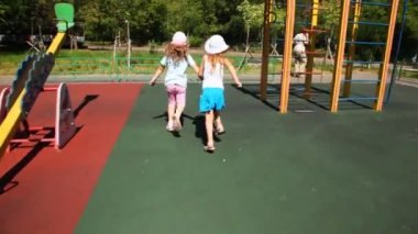 Girls hurry from chamber on child's ground round short flights of stair and mountains — Stock Video