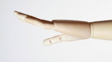 Rotating wooden open palm of mannikin on white — Stock Video
