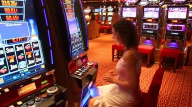 Woman at slot machine in play room in Persian Gulf. — Stock Video