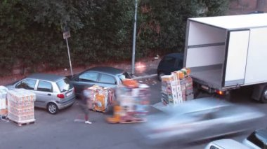 Two men load some cargo on truck with pallet jack in Rome, Italy. — Stock Video