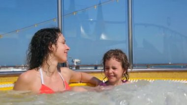 Mother and daughter in hot whirlpool on deck of ship — Stock Video