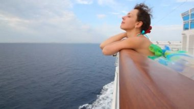 Woman stands on deck of cruise ship — Stock Video