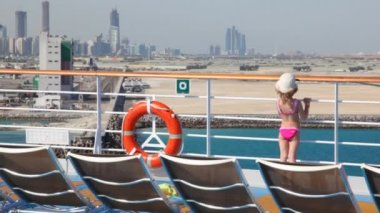 Girl stands on deck of cruise liner — Stock Video