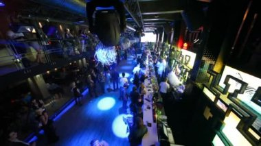 View from about on sitting and relaxing at bar of nightclub — 图库视频影像