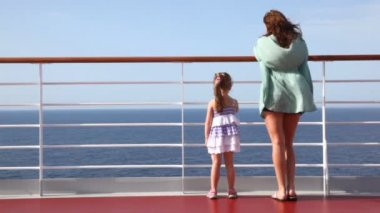 Woman and girl standing on deck — Stock Video