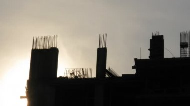 Silhouette of under construction house against sky — Stock Video