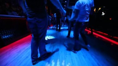 Legs of some young dancing in good nightclub — Stock Video