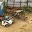 Lift truck operate at construction site at Losiniy Ostrov estate — Wideo stockowe