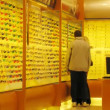 People choose glasses in optical store — Stock Video