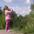Little girl photographs in park. — Stock Video #27971321