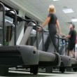People on treadmills at fitness club. — Stock Video