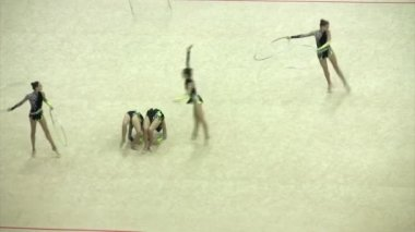 Gymnasts with hoops on XXX World Rhythmic Gymnastics Championship. — Stock Video