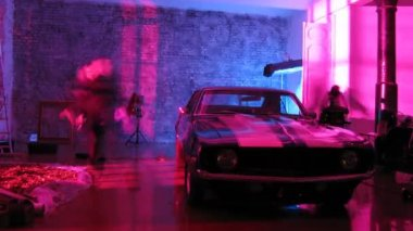 Camera crew videotape nice car in front of wall while producing video clip — Stock Video