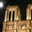 Stock Video: Notre Dame Cathedral, behind night sky