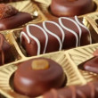 Closeup of sweet chocolates in golden box rotates — Stock Video
