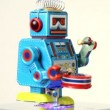 Closeup of blue clockwork robot walks on table, beats drum — Wideo stockowe
