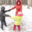 Happy mother with two children (boy and girl) in winter wood. — Stock Video #27981557