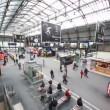 Stock Video: Commuters walk in Paris North Station