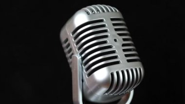 Closeup of iron microphone rotates — Stock Video
