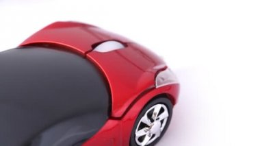 Close-up shot of computer mouse in form of sport car — Stock Video