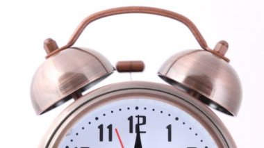 Close-up shot of ringing alarm bell clock on white — Stok video