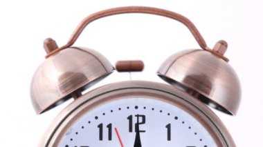 Close-up shot of ringing alarm bell clock on white — Stock Video